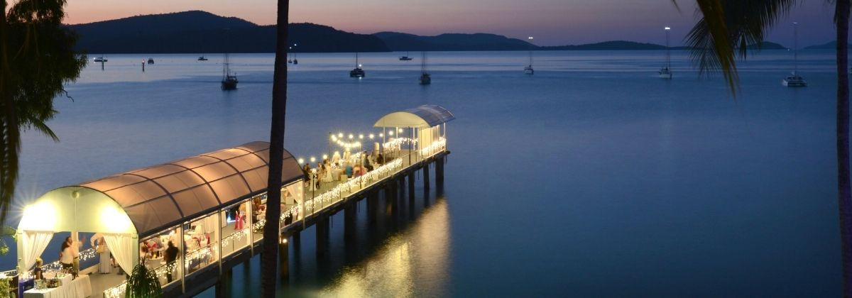 The private Jetty at Coral Sea Marina Resort at night, with a private event and fairy lights