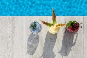 Three cocktails served next to the pool at The Rocks