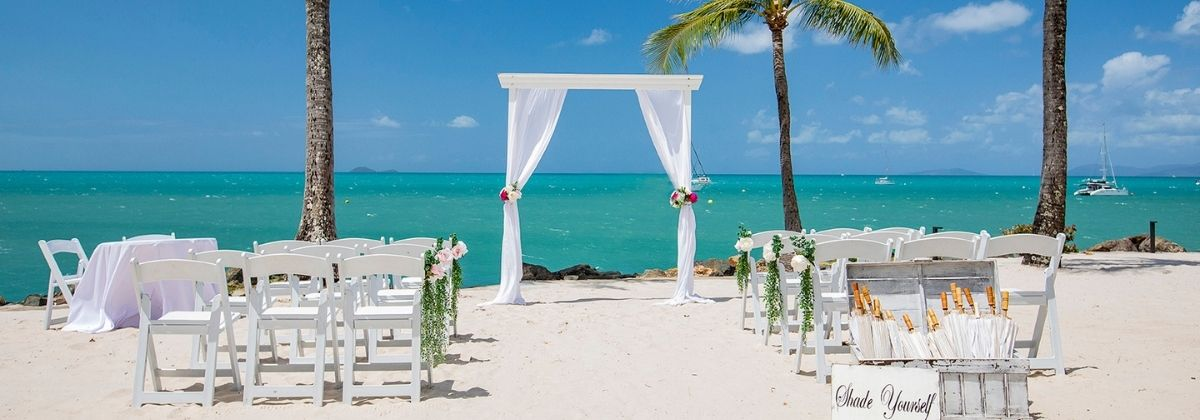 A wedding ceremony set up on The Beach at the Coral Sea Resort Hotel